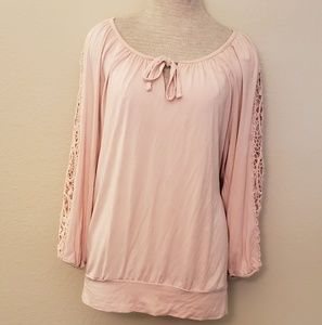 Pink blouse crochet arms